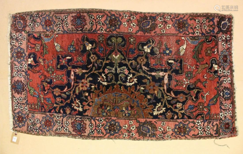 A SMALL PERSIAN RUG, red ground with birds and floral