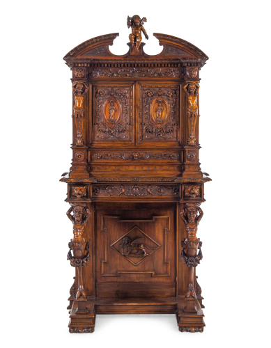 A Renaissance Revival Carved Walnut Cabinet on Stand