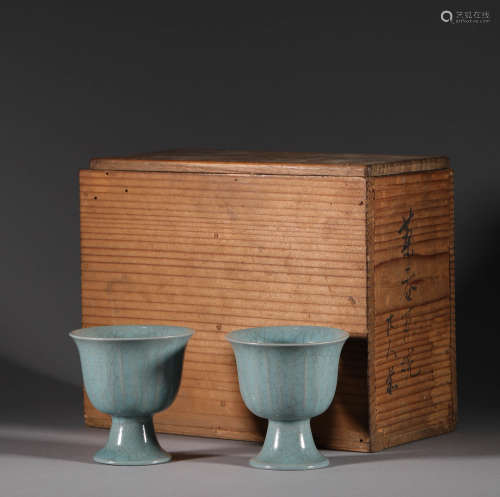A pair of Qing Dynasty celadon wine cups