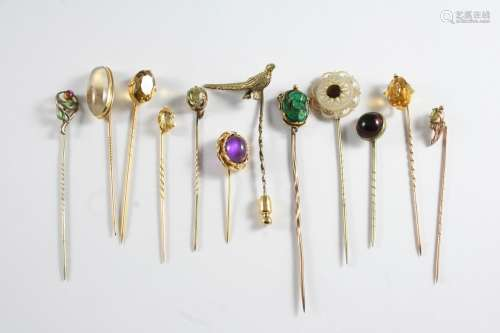 TWENTY SIX ASSORTED STICK PINS a garnet and seed pearl clust...