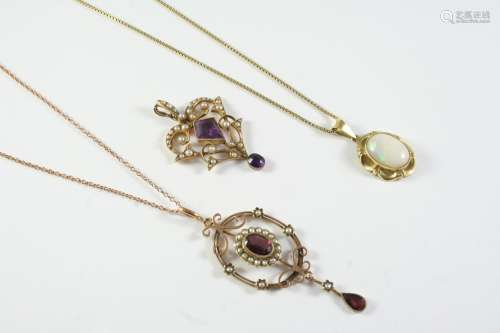AN EDWARDIAN AMETHYST AND PEARL SET PENDANT the gold openwor...