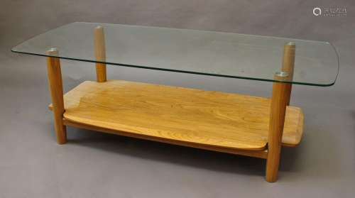 MODERN ERCOL COFFEE TABLE an unusual coffee table with a lig...