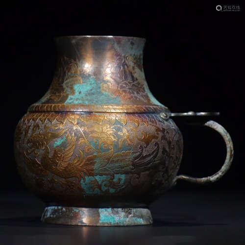 A gilt bronze floral cup