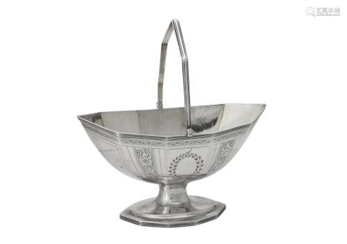 A George III silver shaped oval swing handled pedestal baske...