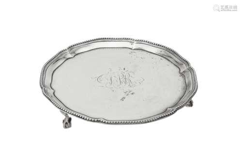 A George III silver shaped circular waiter by Thomas Pratt &...