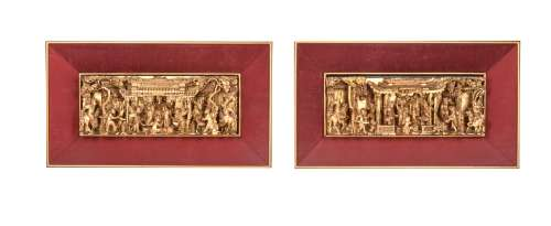 A pair of Chinese high-relief carved wood panels