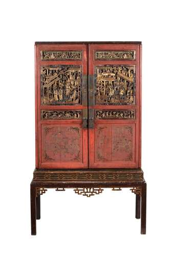 A Chinese red lacquered cabinet on stand