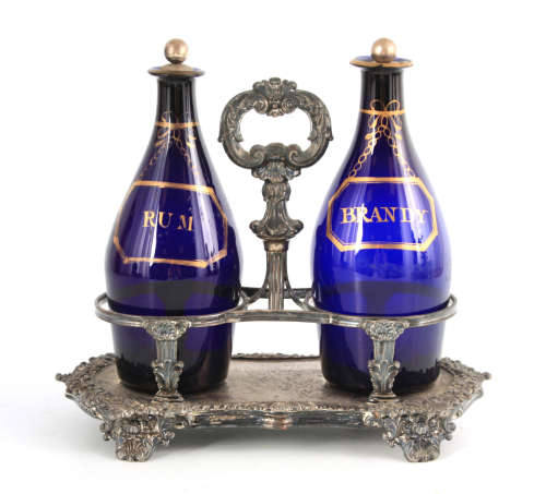 TWO EARLY 19TH CENTURY BRISTOL BLUE DECANTERS FOR RUM AND BR...