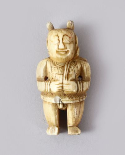 A GOOD EARLY CHINESE CARVED IVORY FIGURE OF A SEMI NUDE MAN ...