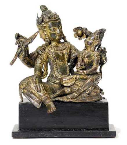 A GILT COPPER ALLOY FIGURE OF A GOD WITH HIS CONSORT.