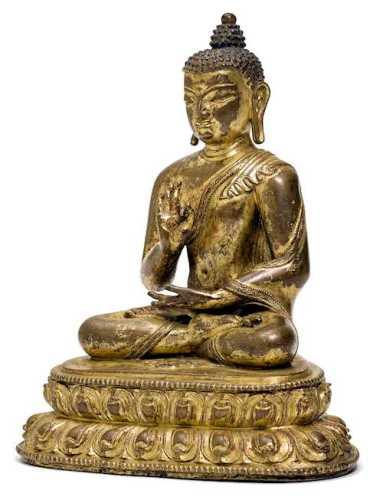 A GILT COPPER ALLOY FIGURE OF A BUDDHA.
