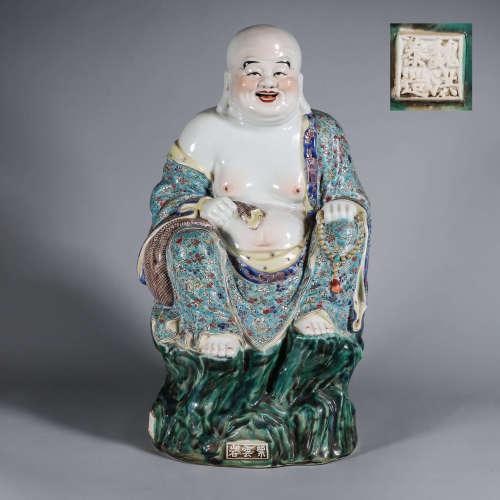 A famille rose porcelain Maitreya statuette
