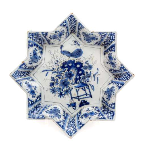 A Dutch Delft blue and white pottery star shaped dish