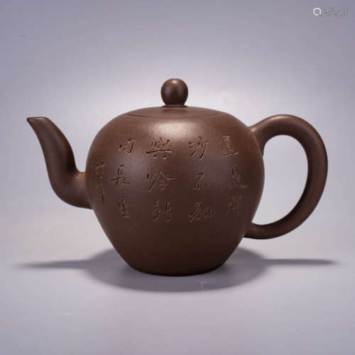 A purple clay inscribed teapot