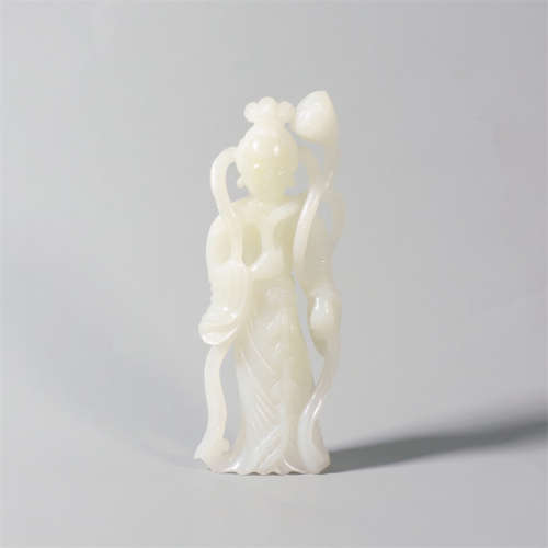 A carved hetian white jade guanyin statue