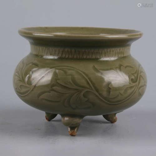 An incised olive-green-glazed tripod incense burner