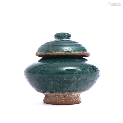 A blue-glazed pottery oblate jar and cover