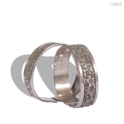 A pair of silver bracelet