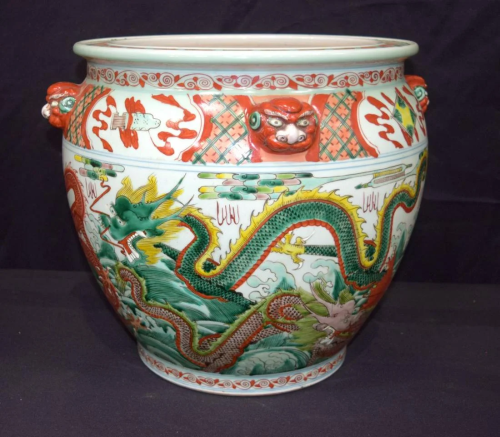 A large Chinese polychrome porcelain planter decorated
