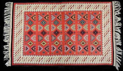 A Turkish red ground Kelim rug