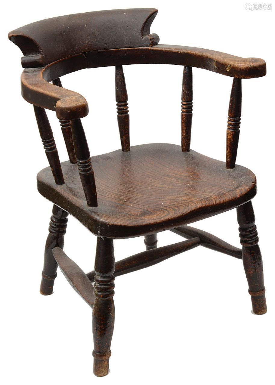 A Victorian stained beechwood child's smokers bow armchair