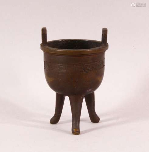 A SMALL 19TH CENTURY CHINESE TWIN HANDLE TRIPOD CENSER, the ...