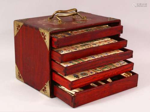 A CHINESE BAMBOO & IVORY BOXED MAHJONG SET - comprising ...