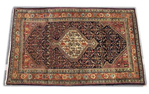 A GOOD PERSIAN RUG, 20TH CENTURY, blue ground, the central p...