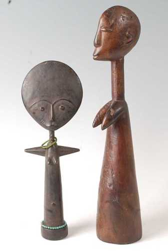 * An Akua'ba fertility doll, having a flattened moon shaped ...