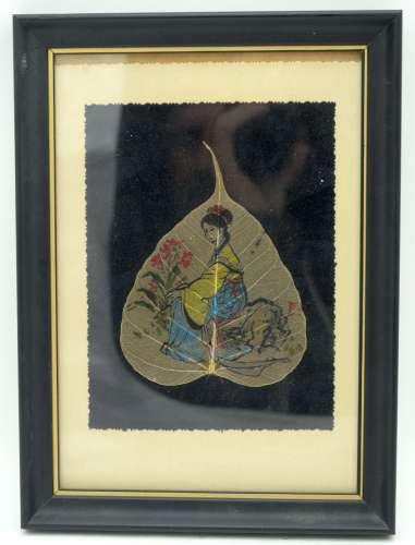 A framed Japanese leaf picture of a female 18 x 13cm