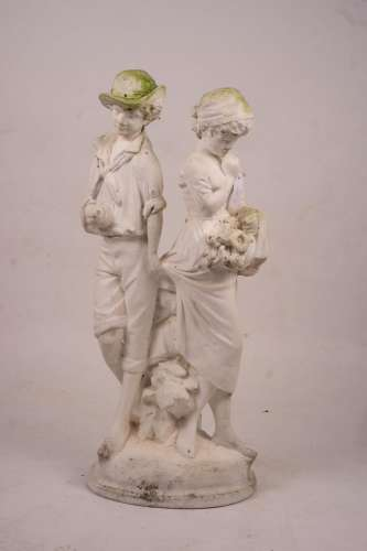A reconstituted stone garden ornament of fruit and flower pi...