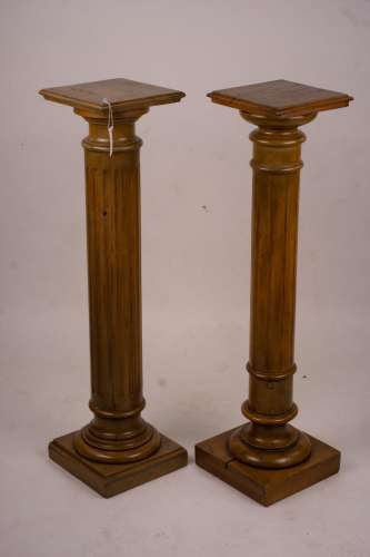 A pair of Victorian style carved beech and walnut pedestals,...