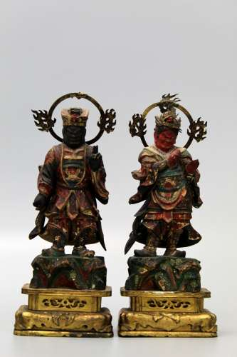 Two Japanese carved wood guardians.