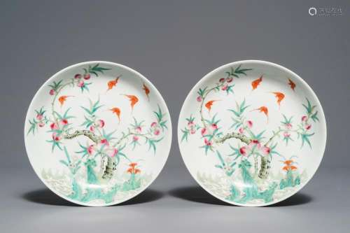 A pair of Chinese famille rose 'bats and peaches' plates, Republic, 20th C.