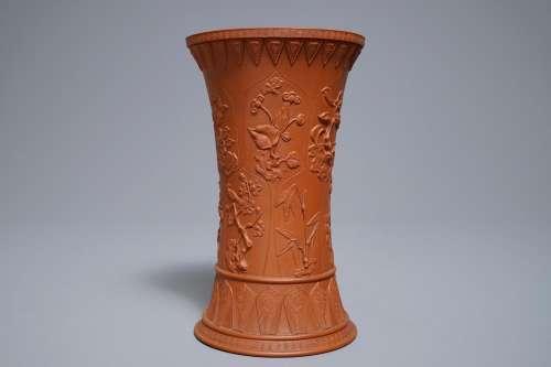 A Chinese Yixing stoneware beaker vase with applied floral design, Kangxi
