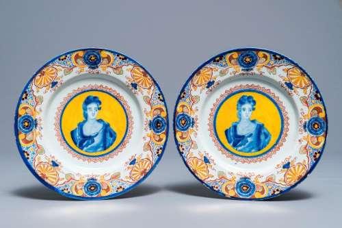 A pair of polychrome Dutch Delft yellow-ground portrait plates, 18th C.