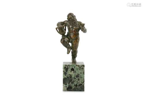 A SMALL LATE 17TH CENTURY ITALIAN BRONZE STATUETTE OF BACCHUS the bearded figure standing on his