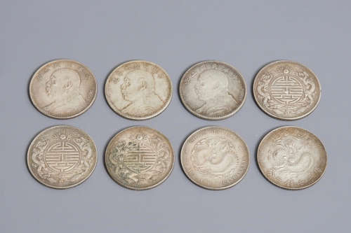 Eight Chinese silver coins, 19/20th C.