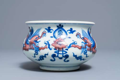 A rare Chinese blue, white and copper red 'dragon' censer, Kangxi