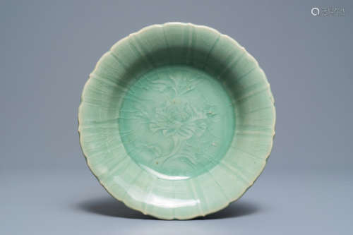 A Chinese Longquan celadon dish with underglaze peony design, Ming