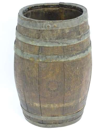 An old oak coopered barrel / stick stand of oval form with brass banding.