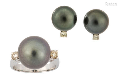 A cultured pearl and diamond ring and earstuds