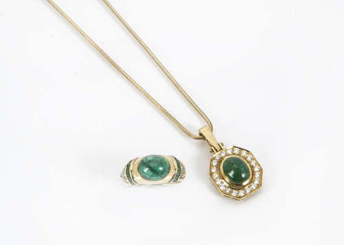 A modern 18ct gold emerald and diamond ring, with a central cabochon emerald with square cuts to the