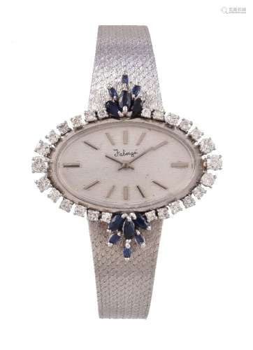 A lady's 18 carat white gold, diamond and sapphire bracelet watch