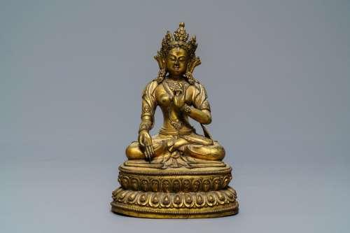 A Sino-Tibetan gilt bronze figure of a White Tara, Ming