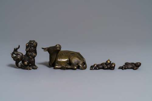 Four Chinese bronze scroll weights, 18/19th C.