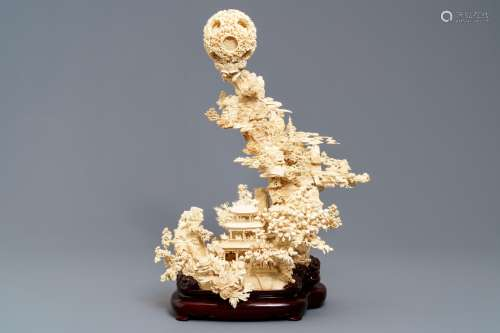 A fine Chinese ivory landscape with a puzzle ball, Canton, ca. 1920