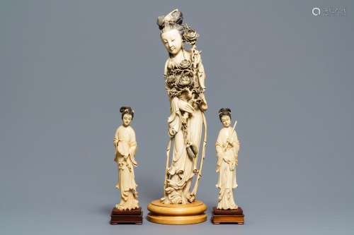 One large and a pair of smaller Chinese ivory figures of court ladies, ca. 1900