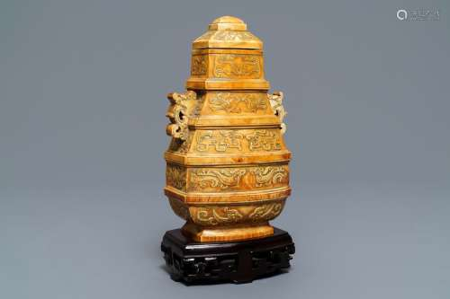A Chinese archaistic ivory vase and cover on wooden stand, ca. 1900