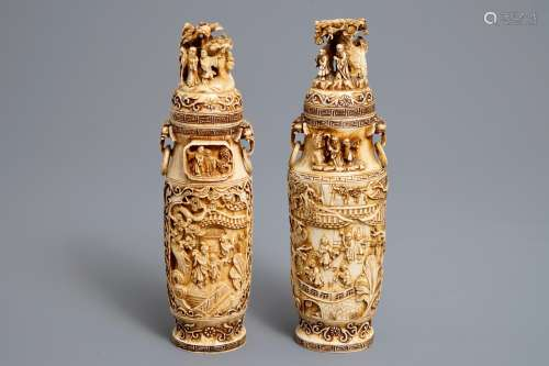 A pair of Chinese ivory vases and covers with figures in landscapes, 1st quarter 20th C.
